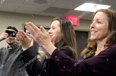 Adrienne Esposito, Maureen Murphy Adrienne Esposito, right, and Maureen Murphy, of the Citizens Campaign for the Environment, applaud a vote by the Long Island Power Authority at its meeting, in Uniondale, N.Y. LIPA approved a contract with Deepwater Wind to construct a 15-turbine offshore wind project about 30 miles east of Montauk, N.Y. Environmentalists and others see the project as another step toward expanding offshore wind energy in the United States