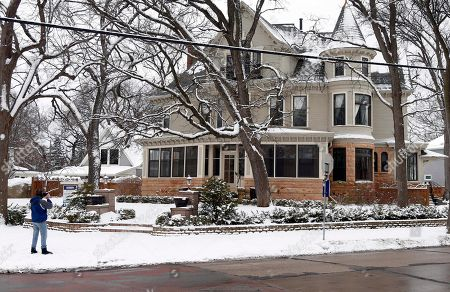 """A fan takes a photo of the Minneapolis home which was the setting for the """"Mary Tyler Moore"""" show is shown . Moore, who died Wednesday at the age of 80, played the part of Mary Richards, a producer for a fictional Minneapolis television station"""