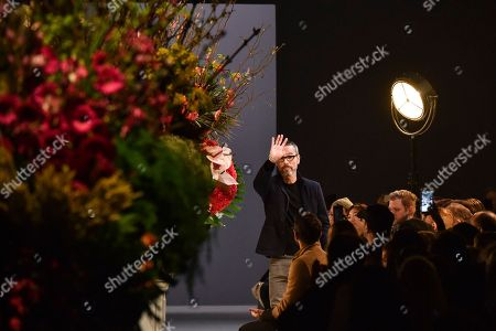 Paris Fashion Viktor and Rolf Dutch fashion designer Rolf Snoeren acknowledges applause from the audience after Viktor and Rolf's Haute Couture Spring-Summer 2017 fashion collection presented in Paris