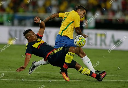 Dudu, Farid Diaz Brazil's Dudu, behind, and Colombia's Farid Diaz vie for the ball during a friendly match at the Nilton Santos stadium in Rio de Janeiro, Brazil, . The match is a tribute to Chapecoense soccer players who died in a plane crash in Colombia last November
