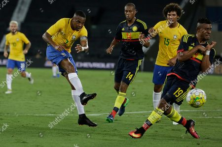 Robinho, Farid Diaz Brazil's Robinho, left, kicks the ball as Colombia's Farid Diaz tries to block during a friendly soccer match at the Nilton Santos stadium in Rio de Janeiro, Brazil, . The match is a tribute to Chapecoense soccer players who died in a plane crash in Colombia last November
