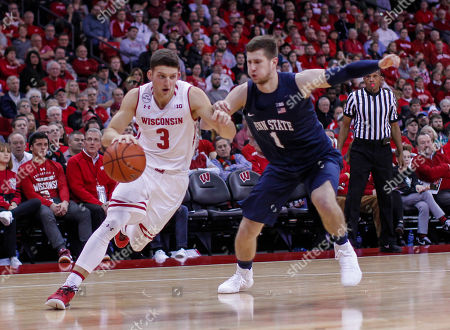 Wisconsin's Zak Showalter (3) and Penn State's Deividas Zemgulis (1) during the second half of an NCAA college basketball game, in Madison, Wis. Wisconsin won 82-55