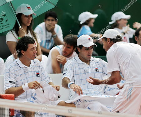 Argentineans Eduardo Schwank (c) and Carlos Berlocq (l) Speak with Their Captain Marin Jaite During the Doubles Game For the Third Point of the Davis Cup Semi-finals Against Czechs Radek Stepanek and Tomas Berdych at Parque Roca in Buenos Aires Argentina 15 September 2012 the Czechs Won Argentina Buenos Aires