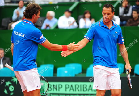 French Tennis Players Julien Benneteau (l) and Michael Llodra Celebrate a Point Against Argentinian David Nalbandian and Horacio Zeballos During Tennis Game As Part of World Group of the Davis Cup at the Stadium Mary Teran De Weiss in Buenos Aires Argentina 06 April 2013 Argentina Buenos Aires