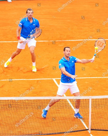 French Tennis Players Julien Benneteau (l) and Michael Llodra Returns a Ball to Argentinian David Nalbandian and Horacio Zeballos During Tennis Game As Part of World Group of the Davis Cup at the Stadium Mary Teran De Weiss in Buenos Aires Argentina 06 April 2013 Argentina Buenos Aires