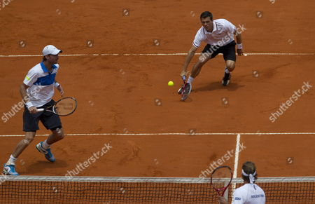 German Tennis Players Tobias Kamke (r) and Christopher Kas (l) in Action Against David Nalbandian (below) and Horacio Zeballos From Argentina in Their Davis Cup Match Held in the Roca Park in Buenos Aires Argentina 02 February 2013 Argentina Buenos Aires