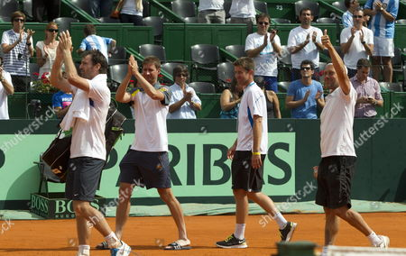 German Tennis Players (l-r) Christopher Kas Florian Mayer Michael Kohlmann and Captain Carsten Arriensde Leave the Court After Being Defeated by Argentina in Their Davis Cup Match Held in the Roca Park in Buenos Aires Argentina 02 February 2013 Argentina Buenos Aires