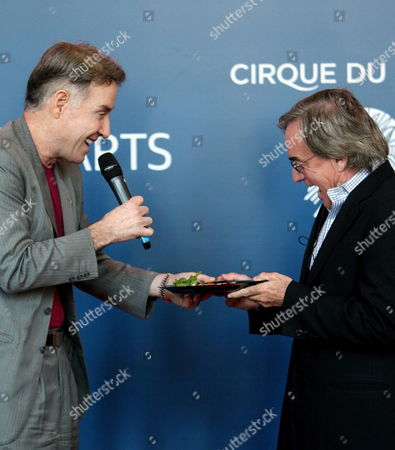 Brazilian Tycoon Eike Batista (l) and President of Cirque Du Soleil Daniel Lamarre (r) Give a Press Conference in Rio De Janeiro Brazil 25 September 2012 to Announce a Partnership Between Batista's Company Imx and Cirque Du Soleil to Promote This Show in the South American Countries the Agreement Between the Brazilian Company and Canadian Circus Includes the Creation of a New Company Called Imx Arts Based in Rio De Janeiro to Exploit the Shows and Spread Social Initiatives in the Region Brazil Río De Janeiro