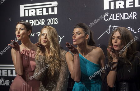 (l-r) Models Hanaa Ben Abdesslem Petra Nemcova Summer Rayne Oakes and Elisa Sednaoui Send Kisses to Journalists During the Red Carpet of the Gala Dinner to Present the Pirelli Calendar 2013 in Rio De Janeiro Brazil 27 November 2012 the Calendar was Made by Photojournalist Steve Mccurry Brazil Rio De Janeiro