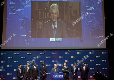From L-r Mayors Won Soon Par of Seoul Eckart Wuerzner of Heidelberg Franklyn Tau of Johannesburg Babatunde Fashola of Lagos Michael R Bloomberg of New York Eduardo Paes of Rio De Janeiro Mauricio Macri of Buenos Aires and Gilberto Kassab of Sao Paulo Listen the Speech of Former Us President Bill Clinton (on Screen) During the 'C40' the Meeting of the Mayors From the 40 World´s Main Cities in Rio De Janeiro Brazil 19 June 2012 where the Un Conference For Sustainable Development Rio+20 is Held the Un Conference on Sustainable Development (rio+20) Held This Week Seeks a Change of Paradigm to Foster a More Sustainable Global Economy Brazil Rio De Janeiro