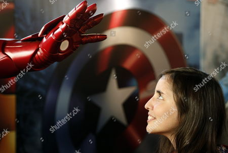 A Picture Made Available on 25 May 2013 Shows a Visitor Looking at the Iron Man's Hand During the Third Edition of the 'Comic with Chile' Event at the Mapocho Station in Santiago Chile on 24 May 2013 Thousands of Visitors Gather to Disguise As Their Favourite Comic Stars and Characters Discover New Creators Purchase Merchandise Or Simply Admire the Collections of the Most Inconditional Fans This Year 'Comic with Chile' is Attended by Boyd Along with His Canadian Colleague Nicholas Lea (alex Krycek in 'X Files') Epa/felipe Trueba Chile Santiago