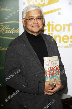 Amitav Ghosh with his book The Sea of Poppies