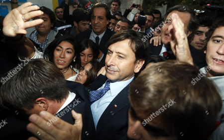 Laurence Golborne (c) Presidential Candidate From the Right-wing Party Independent Democratic Union (udi) Upon His Arrival to the Party's Headquarters in Santiago De Chile Chile 29 April 2013 where He Announced His Resignation From the Nomination After a Financial Scandal Chile Santiago De Chile