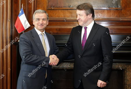 Chilean Minister of Treasury Felipe Larrain (l) Receives Mayor of London Roger Gifford (r) Prior to a Meeting at Treasuty Ministry in Santiago Chile 08 July 2013 Larrain and Gifford Talked About the Upcoming September 2013 'Chile Day' Event Which Will Be Held in London Britain Chile Santiago