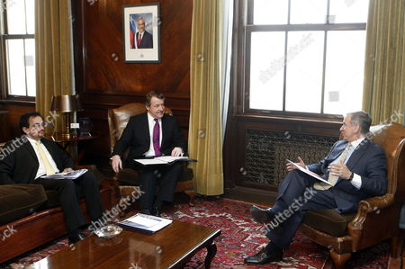 Chilean Minister of Treasury Felipe Larrain (r) Meets with Mayor of London Roger Gifford (c) and British Ambassador in Chile Jon Benjamin (l) at Treasury Ministry in Santiago Chile 08 July 2013 Larrain and Gifford Talked About the Upcoming September 2013 'Chile Day' Event Which Will Be Held in London Britain Chile Santiago