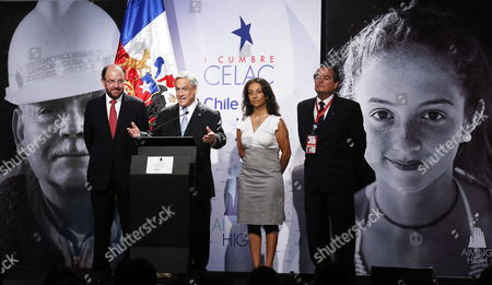 Stock Image of Chilean President Sebastian Pinera (2 L) Next to Chilean Foreign Minister Alfredo Moreno (l) Chilean Government Spokeswoman Cecilia Perez (2 R) and Summit Executive Secretary Fernando Barrera Talks on 22 January 2013 During the Inauguration of the Entry of Espacio Riesco where Will Be Hold the First Celac - Eu Summit on 26 and 27 January in Santiago De Chile Chile More Than 40 Heads of State and Government of the Community of Latin American and Caribbean States (celac) and European Union (eu) Will Meet to Promote a Strategic Partnership Between the Two Regions Chile Santiago De Chile