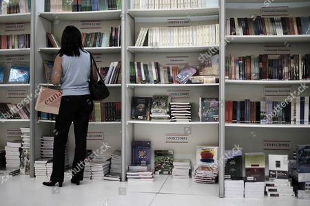 A Woman Looks at Books During the Xiii International Book Fair in San Jose Costa Rica Which Opens Its Doors with an Edition Dedicated to Afro-caribbean Culture and with the Nobel Prize Literature Winner Derek Walcott As Special Guest 24 August 2012 in Total 46 Local and International Exhibitors From Countries Such As Guatemala Mexico El Salvador Peru Spain Nicaragua and Caribbean Nations Will Present Their Works Until 02 September 2012 Costa Rica San Jose