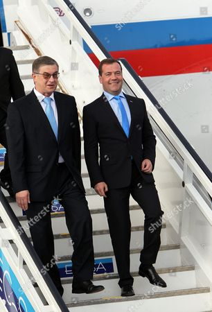 Russian Prime Minister Dimitry Medvedev (r) Descends From the Airplane with an Advisor at the Havana's International Airport in Havana Cuba 21 February 2013 Medvedev is Officially Visiting the Island where He Will Meet with President Raul Castro and Reinforce Trade and Cooperation Relations Between Both Countries Cuba Havana