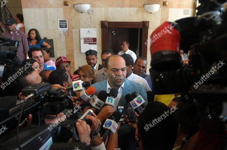 Stock Image of Lawyer Felix Portes (c) Defendant of Dominican Singer Martha Heredia Speaks to Reporters at the Justice Palace in Santiago Dominican Republic 22 February 2013 Heredia Winner of Reality Show Latin American Idol in 2009 was Detained on 21 February 2013 After Allegedly Trying to Smuggle 1 2 Kilos of Heroine to the United States the Artist Could Face 20 Years in Prison Dominican Republic Santiago