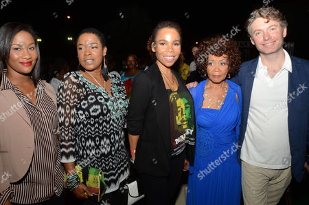 British Director of Documentary 'Marley' Kevin Macdonald (r) Poses Next to Zuri (l) Sharon (2-l) and Cedella (c) Duaghters of Bob Marley and Constance (2-r) Sister of the Legendary Jamaican Musician During the Premiere of the Film at Emancipation Park in New Kingston Jamaica 19 April 2012 Jamaica New Kingston