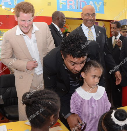 Britain's Prince Harry (l) Jamaica's General Governor Sir Patrick Allen (r) and Us-born Jamaican Singer Shaggy Meet to a Group of Children at the Children Hospital Bustamante in Kingston Jamaica on 6 March 2012 Prince Harry is on an Official Visit to the Country As Part of the 60th Anniversary of the Queen Elizabeth Ii Jubilee Jamaica Kingston