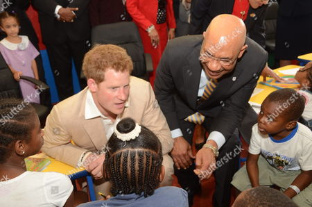 Britain's Prince Harry (l) Jamaica's General Governor Sir Patrick Allen (r) Meet to a Group of Children at the Children Hospital Bustamante in Kingston Jamaica on 06 March 2012 Prince Harry is on an Official Visit to the Country As Part of the 60th Anniversary of the Queen Elizabeth Ii Jubilee Jamaica Kingston