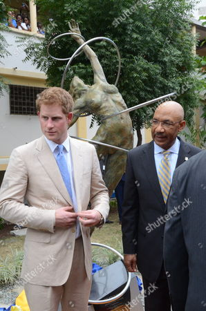Britain's Prince Harry (l) and Jamaica's General Governor Sir Patrick Allen (r) After Unveiling a Statue at the Hospital Victoria Jubilee in Kingston Jamaica on 6 March 2012 Prince Harry is on an Official Visit to the Country As Part of the 60th Anniversary of the Queen Elizabeth Ii Jubilee Jamaica Kingston