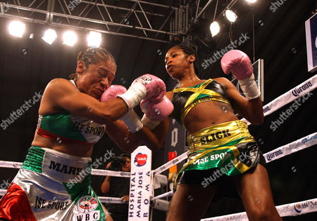 Stock Picture of Jamaican Boxer Alicia Ashley (r) in Action Against Mexican Maria Elena Villalobos During Their Fight For the World's Title Junior Featherweight From the World Boxing Council in Mexico City 17 March 2012 Mexico Mexico City