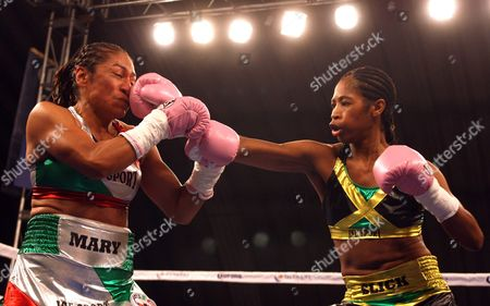 Stock Image of Jamaican Boxer Alicia Ashley (r) in Action Against Mexican Maria Elena Villalobos During Their Fight For the World's Title Junior Featherweight From the World Boxing Council in Mexico City 17 March 2012 Mexico Mexico City