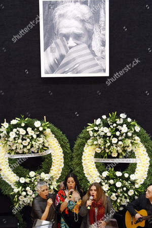 Singers Eugenia Leon (r) Tania Libertad (l) and Lila Dawns (c) Sing Next to the Coffin with the Remains of Famous Costa Rican Ranchera Singer Chavela Vargas at the Fine Arts Palace of Mexico City Mexico 07 August 2012 where a Tribute Will Be Given and Thousands of People Will Be Able to Visit Vargas Died on Sunday at Age 93 Due to a Respiratory Failure Mexico Mexico City