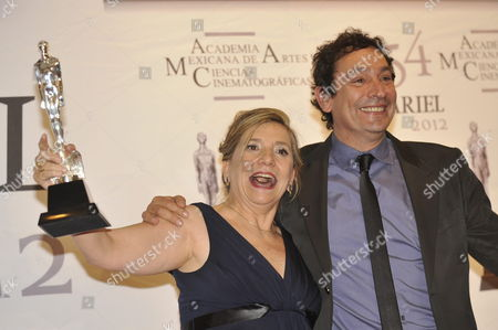 Spanish Isona Passola (l) and Agusti Villaronga (r) Pose with Their Ariel For the Film 'Pa Negre' (black Bread) For Best Ibero American Film at Palacio De Bellas Artes Y Mexico City Mexico 02 June 2012 Ariels Are Granted by Mexican Academy of Arts and Cinematographic Sciences Mexico Mexico City