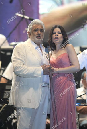 Spanish Singer Placido Domingo (l) Performs Next to Puerto Rican Soprano Ana Maria Martinez (r) During a Concert For the Benefit of Child Orchestras in Tamarindos Beach Acapulco Mexico Late 29 December 2012 Mexico Acapulco