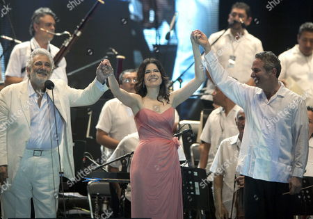 Spanish Singer Placido Domingo (l) Together with Puerto Rican Soprano Ana Maria Martinez (c) and Us Conductor Eugene Kohn (r) During a Concert For the Benefit of Child Orchestras in Tamarindos Beach Acapulco Mexico Late 29 December 2012 Mexico Acapulco