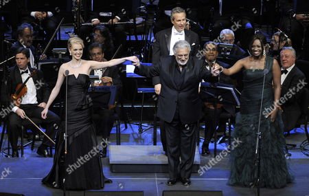Stock Photo of Spanish Tenor Placido Domingo (c) Holds Hands with Us Sopranos Angel Blue (r) and Micaela Oeste (l) During a Performance Part of the Activities of the 60 Years of the Auditorio Nacional in Mexico City Mexico 20 June 2012 Mexico Mexico City