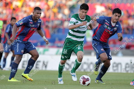 Oribe Peralta (c) of Santos Fights For the Ball Against Jorge Guagua (l) and Luis Venegas (r) of Atlante During the Apertura Tournament Soccer Match Held at Andres Quintana Roo Stadium in Cancun City Mexico on 30 September 2012 Mexico Cancun