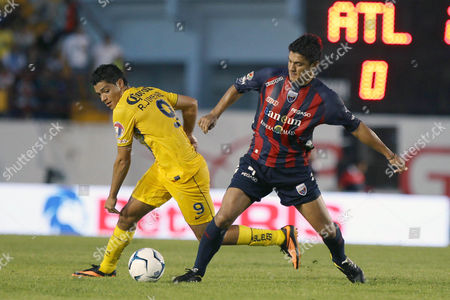 Mexican America Soccer Team Player Raúl Jiménez (l) Fights For the Ball with Atlante's Luis Venegas (r) During an Apertura Tournament Soccer Match Held at the Andres Quintana Roo Stadium in Cancun Mexico 10 August 2013 Mexico Cancún