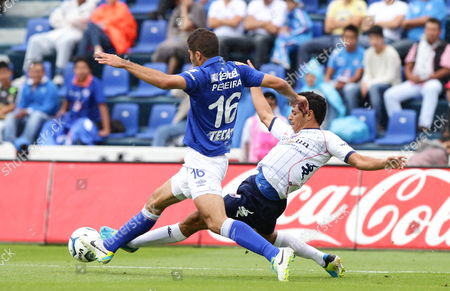 Jair Pereira (l) From Cruz Azul Vies For the Ball Against Manuel Alejandro Vela (r) From Atlante From Their Match of the Apertura Tournament Held at the Azul Stadium in Mexico City Mexico 17 August 2013 Mexico Mexico City