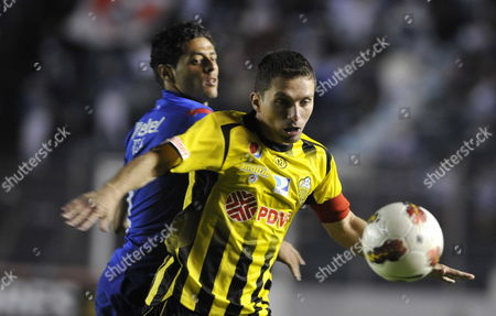 Stock Picture of Alejandro Vela (back) of Cruz Azul Vies For the Ball with Gerzon Chacon (front) of Deportivo Tachira During a Soccer Match For the Libertadores Cup at the Azul Stadium in Mexico City Mexico 21 February 2012 Mexico Mexico City