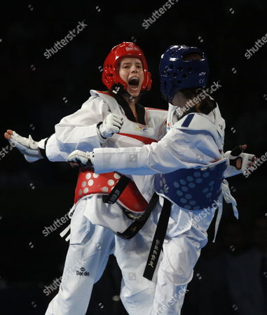Stock Picture of South Korea's Yu-jin Kim (r) Fights Against Croatia's Ana Zaninovic (l) in the Category of -53 Kg During the Fourth Day of the World Championship of Taekwondo in Puebla Mexico 18 July 2013 Mexico Puebla