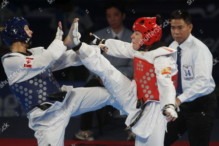 Spain's Elena Gomez (r) Fights Against Canada's Jasmine Vokey (l) in the Category of -73 Kg During the Fifth Day of the World Championship of Taekwondo in Puebla Mexico 19 July 2013 Mexico Puebla