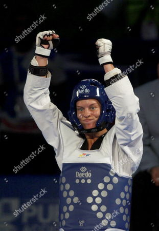Canada's Jasmine Vokey Celebrates After Defeating Spain's Elena Gomez in the Category of -73 Kg During the Fifth Day of the World Championship of Taekwondo in Puebla Mexico 19 July 2013 Mexico Puebla