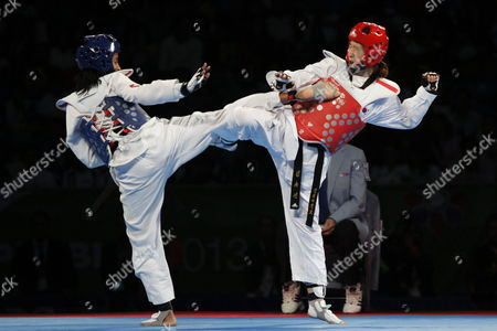 Cuba's Yamisel Nunez (l) Fights Against South Korea's Yu-jin Kim (r) in the Category of -53 Kg During the Fourth Day of the World Championship of Taekwondo in Puebla Mexico 18 July 2013 Mexico Puebla