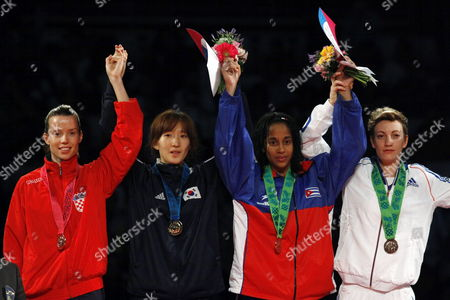 Stock Photo of (l-r) Coratia's Ana Zaninovic Silver Medal South Korea's Yu-jin Kim Gold Medal and Cuba's Yamisel Nuinez and France's Floriane Liborio Bronze Medal in the Podium of in the Category of -53 Kg During the Fourth Day of the World Championship of Taekwondo in Puebla Mexico 18 July 2013 Mexico Puebla