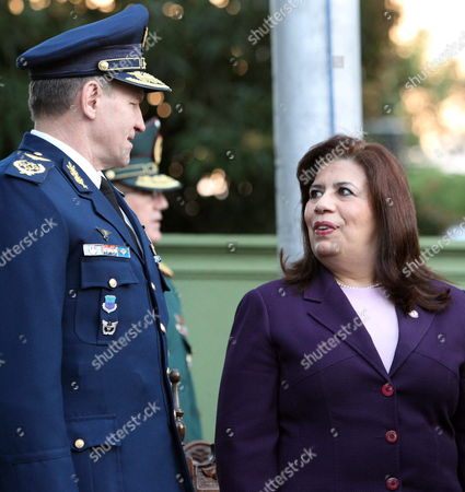 Paraguayan Minister of National Defense Maria Liz Garcia (r) Talks to Paraguayan Chief of the Air Force General Miguel Christ (l) During a Military Ceremony in Asuncion Paraguay 28 June 2012 Garcia Dennounced Venezuelan Foreign Minister Nicolas Maduro Tried to 'Incite to Rebellion' the Armed Forces of Paraguay when He was in Asuncion on Last Week Paraguay's New Government Has Stated That Neighbors Argentina Brazil and Uruguay Are Plotting Against It to Widen Paraguay's Diplomatic Isolation As Punishment For Having Impeached and Removed Fernando Lugo From the Presidency Paraguay Asuncion