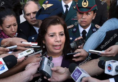 Paraguayan Minister of National Defense Maria Liz Garcia (c) Speaks to Journalists in Asuncion Paraguay 28 June 2012 Garcia Dennounced Venezuelan Foreign Minister Nicolas Maduro Tried to 'Incite to Rebellion' the Armed Forces of Paraguay when He was in Asuncion on Last Week Paraguay's New Government Has Stated That Neighbors Argentina Brazil and Uruguay Are Plotting Against It to Widen Paraguay's Diplomatic Isolation As Punishment For Having Impeached and Removed Fernando Lugo From the Presidency Paraguay Asuncion