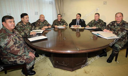 (l-r) General of Divison Julio Peralta Commander of Navy Juan Carlos Benitez Commander of Army Adalberto Garcete Commander of Military Forces Felipe Melgarejo Paraguayan New President Federico Franco Commander of Air Force Miguel Chist and Director of High Strategies Institute Luis Noceda During Sit Together in Their First Meeting in Asuncion Paraguay 27 June 2012 the Organization of American States Oas is to Meet in Washington Usa Later on 27 June 2012 with the Impeachment of Paraguay's President Fernando Lugo at Top of Agenda Paraguay Asuncion