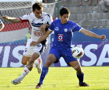 Mexican Cruz Azul's Manuel Alejandro Vela (r) Vies For the Ball Against Paraguayan Nacional's Derlis Orue (l) During a Match of the Copa Libertadores in Asuncion Paraguay 08 February 2012 Paraguay Asuncion