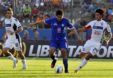 Mexican Cruz Azul's Manuel Alejandro Vela (c) Vies For the Ball Against Paraguayan Nacional's Ricardo Mazzacote (r) and Derlis Orue (l) During a Match of the Copa Libertadores in Asuncion Paraguay 08 February 2012 Paraguay Asuncion