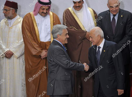 (top) Foreign Minister of Morocco Saad Dine El Otmani (l) Minister of State For Foreign Affairs of Qatar Khalid Al-attyah Mohamed (2l) and Foreign Minister of Kuwait Sheik Al Khalid Al Hamad Al Sabahsabahy (2r) (down) Chilean President Sebastian Pinera (l) and General Secretary of Arab League Nabil Al Araby (r) During the Family Photo of the 3rd Summit of South America-arab Countries at National Theatre of Lima Peru 02 October 2012 the Summit Began with the Call to Reinforce the Relations Between Two Regions and Declarations Over the Situation of Countries As Syria and Palestine Peru Lima