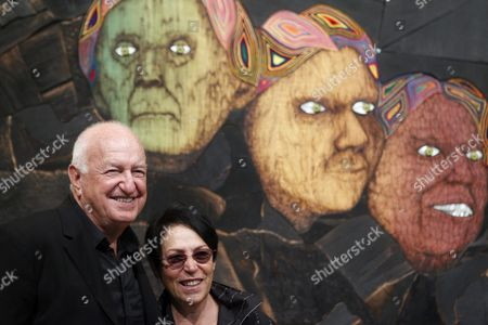 Don (l) and Mera (2-l) Rubell Owners of the Rubell Family Collection Pose For Photographers in Front of the Painting 'Rushmore' by Us Artist Matthew Day Jackson During the Presentation of the Exhibition 'Paintings' at Banco Santander Foundation's Gallery in Boadilla Del Monte Village Outside Madrid Spain 10 February 2012 the Exhibition Running Until 17 June 2012 Features Several Artworks From the Rubell Family Collection Spain Boadilla Del Monte